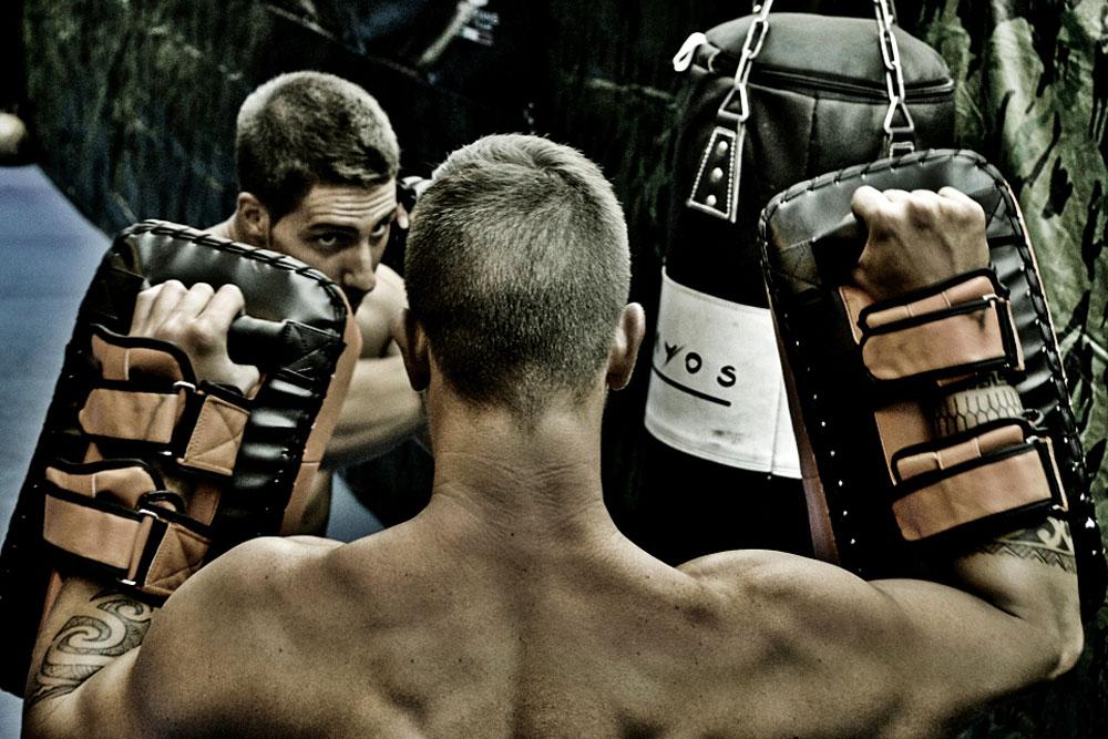 Krav Maga Training striking workout with pads with expert padman