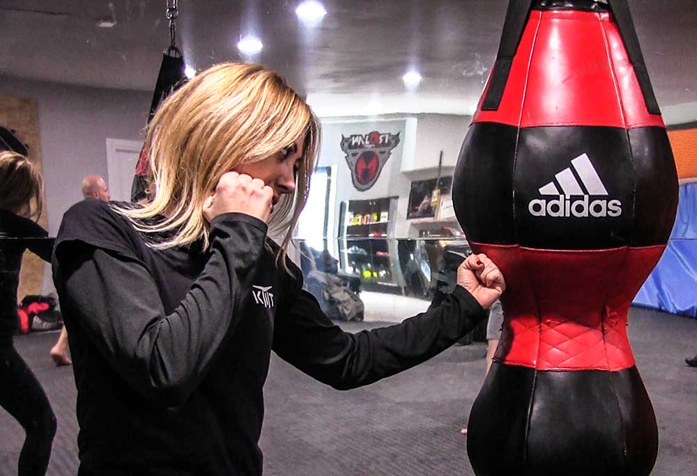 Federica Scalvini punching the Adidas bag