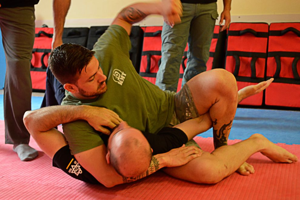 ground and pound with kesa gatame position