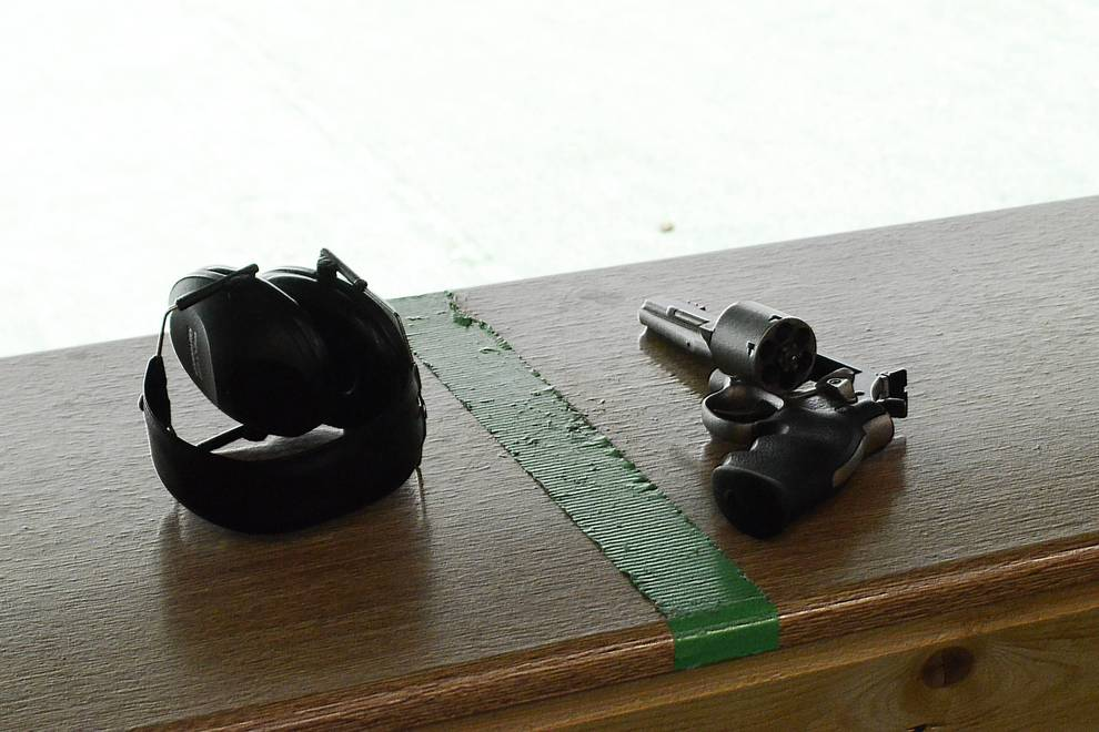 Gun shooting with revolver in the shooting range