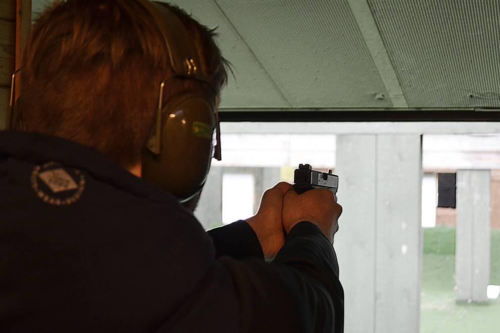 Gun shooting lesson in the shooting range