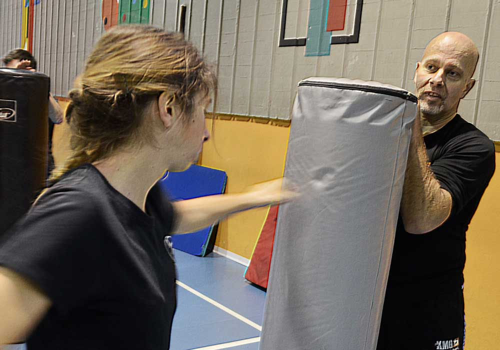 Girl training in boxing combinations