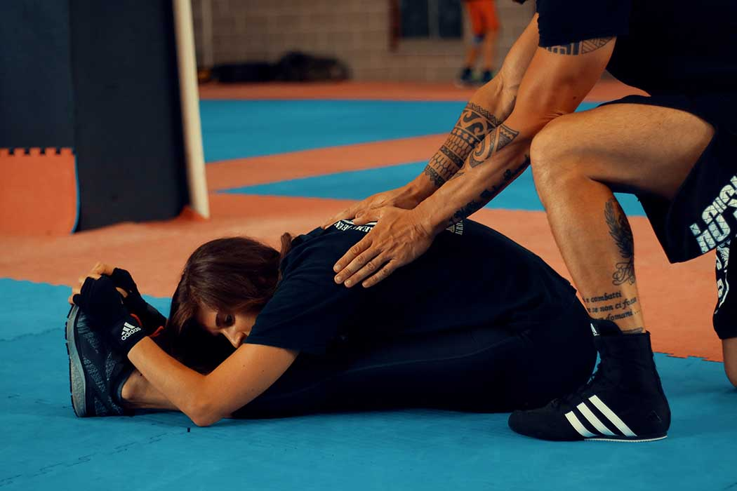 Krav Maga Training stretching girl after the workout | FOTO | PHOTOS