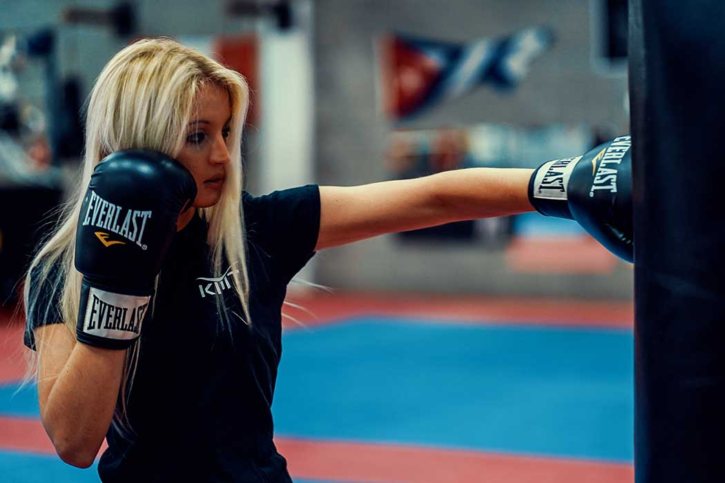 blonde girl punch with gloves